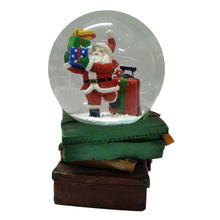Santa Claus with gift snow globe